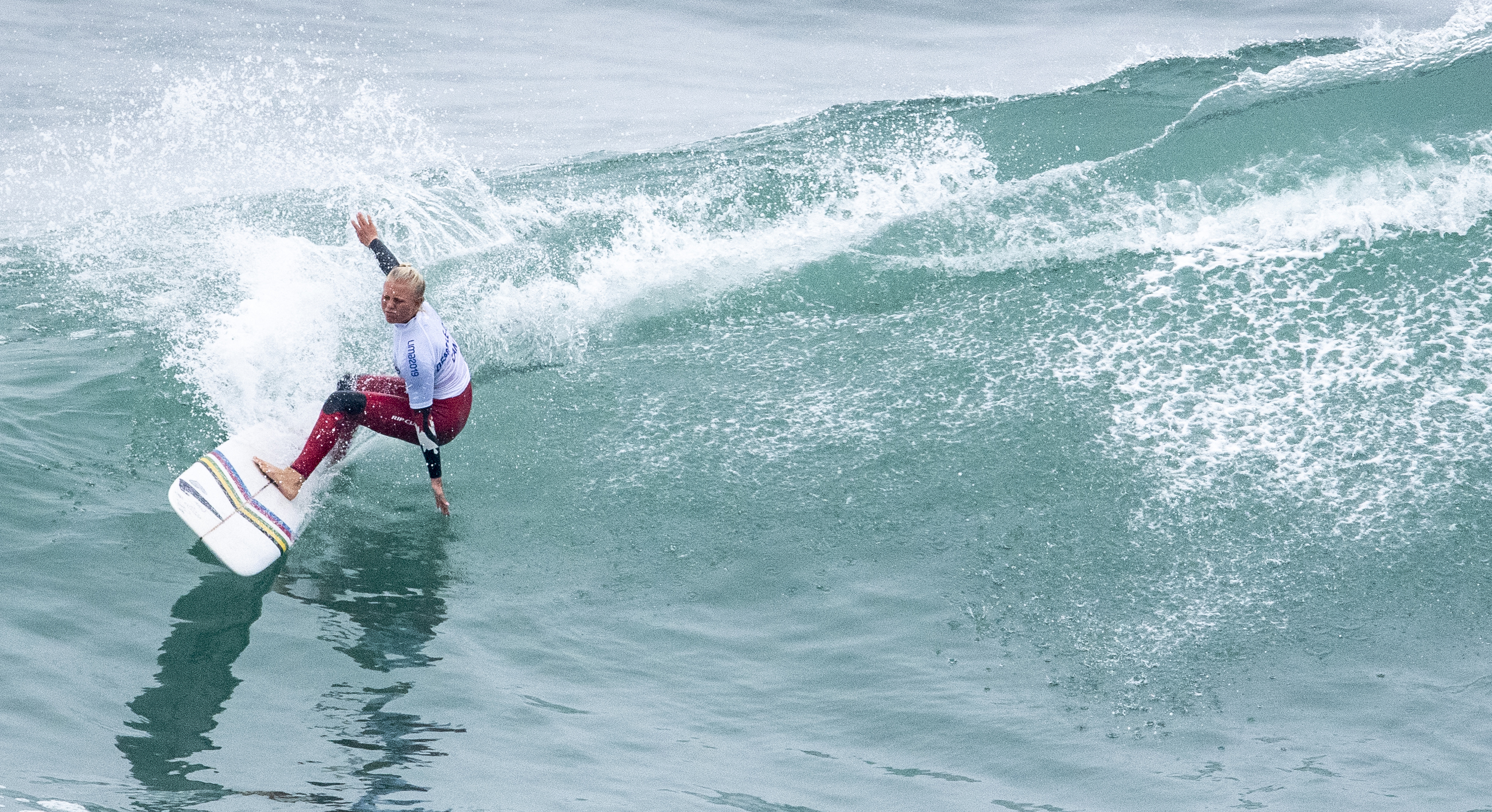 Mathea Olin of Canada competes in the women's longboard finals at the Lima 2019